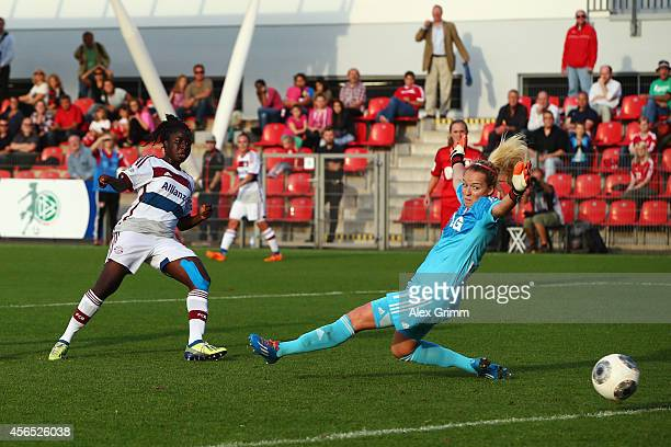 Eunice Beckmann of Muenchen scores her team's third goal against goalkeeper Lisa Schmitz of Leverkusen during the Allianz FrauenBundesliga match...