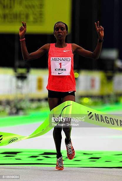 Eunice Jepkir Kirwa of Bahrain crosses the finishing tape to win the Nagoya Women's Marathon at the Nagoya Dome on March 13 2016 in Nagoya Aichi Japan