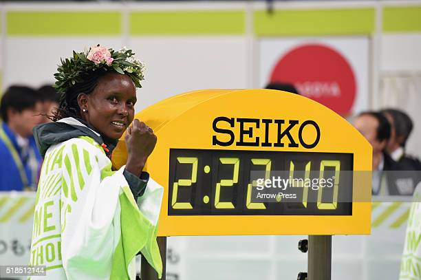 Eunice Jepkir Kirwa of Bahrain poses with her time after winning the Nagoya Women's Marathon 2016 on March 13 2016 in Nagoya Japan