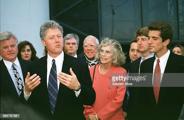 Eunice Kennedy along with John F Kennedy Jr Patrick Kennedy right and brother Ted Kennedy listen to President Bill Clinton speak at the inauguration...
