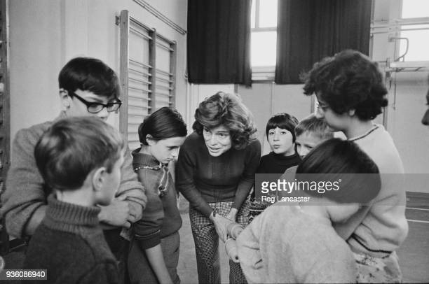 Eunice Kennedy Shriver talking to children during a gym class at a school for children with differing abilities, France, 20th November 1968.