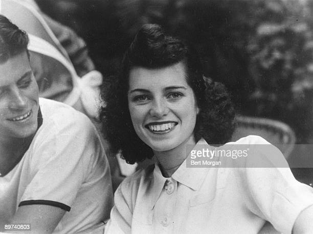 Eunice Kennedy smiles sitting next to her brother Jack Kennedy, Palm Beach, Florida, 1941.