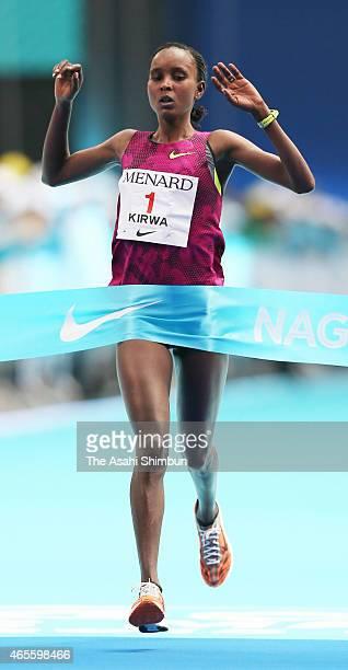 Eunice Kirwa of Bahrain crosses the finishing tape to win the Nagoya Women's Marathon 2015 at Nagoya Dome on March 8 2015 in Nagoya Aichi Japan