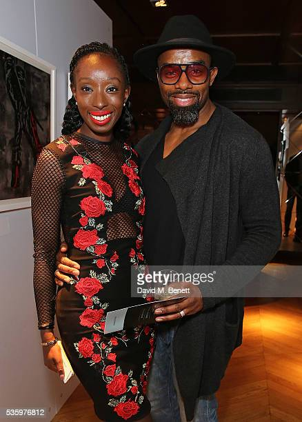 Eunice Olumide and Charles Venn attend the Olumide Gallery's new exhibition exploring socioeconomic issues through inspiring sculptures prints...