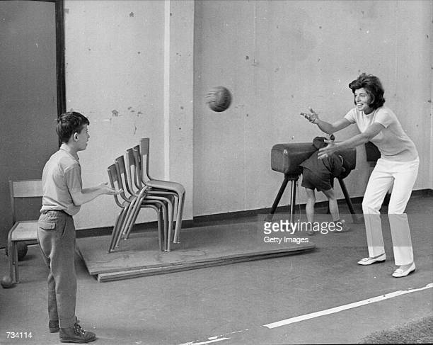 Eunice Shriver seen playing ball with a mentally handicapped child in Paris 1969. Shriver, founder of the Special Olympics was on a trip to Europe...