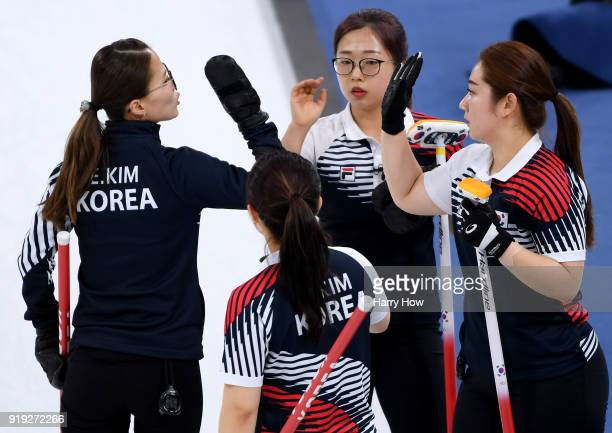 EunJung Kim KyeongAe Kim SeonYeong Kim and YeongMi Kim celebrate a score in a match against Great Britain during the Women's Curling Round Robin on...