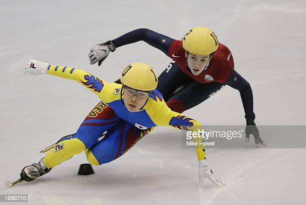 EunKyung Choi of Korea leads Caroline Hallisey of the USA in the women's 1000m speed skating final during the Salt Lake City Winter Olympic Games on...