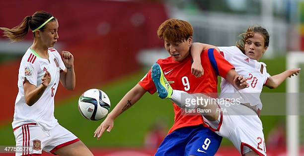 Eunsun Park of Korea is challenged by Irene Paredes of Spain during the FIFA Women's World Cup 2015 Group E match between Korea Republic and Spain at...