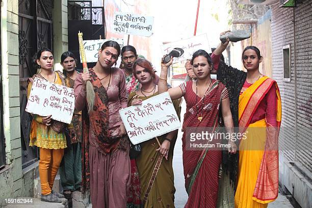 Eunuchs armed with brooms sticks sandals and playcards with hard hitting antirape slogans on January 4 2013 in New Delhi India Moved by recent Delhi...