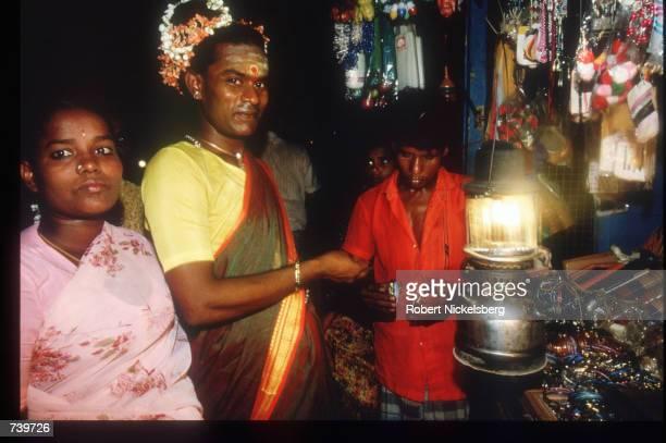 "Eunuchs buy bangles for the Chittirai-Pournami festival April 24, 1994 in Villupuram, India. Eunuchs, called ""hijras"" are mostly men castrated at..."