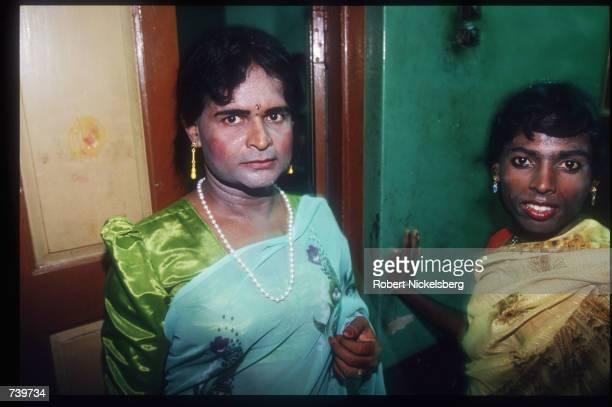 Eunuchs get dressed for the ChittiraiPournami festival in a hotel room April 24 1994 in Villupuram India Eunuchs called hijras are mostly men...