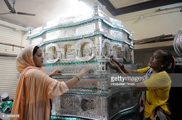 Eunuchs preparing traditional silver Tazia ahead of Muharram festival on October 9 2016 in Bhopal India Muharram is the first month of the Islamic...