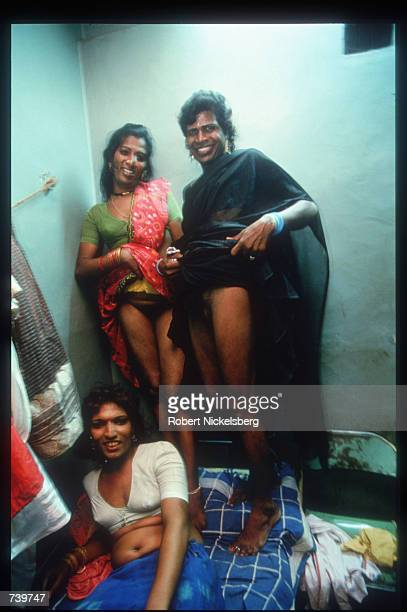 Eunuchs sit in a hotel room April 24 1994 in Villupuram India Eunuchs called hijras are mostly men castrated at puberty were once invited to weddings...