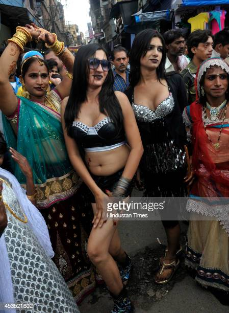 Eunuchs take part in a procession to celebrate Bhujaria festival on August 12 2014 in Bhopal India During Bhujaria festival eunuchs from all over the...
