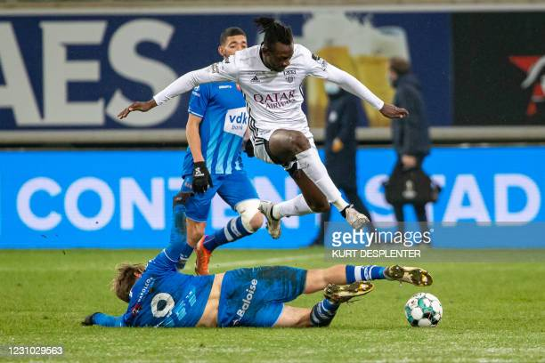 Eupen's Amara Baby and Gent's Roman Bezus fight for the ball during a soccer match between KAA Gent and KAS Eupen, Sunday 07 February 2021 in Gent,...