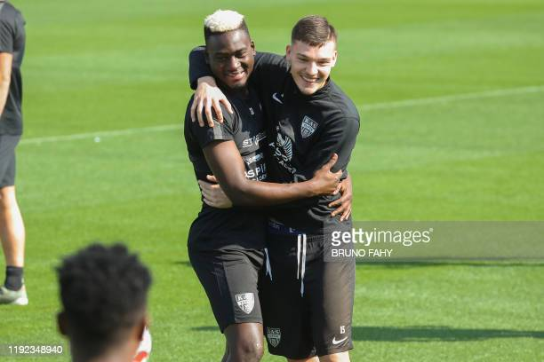 Eupen's Carlos Embalo and Eupen's Gary Magnee pictured during the winter training camp of Belgian first division soccer team KAS Eupen in Doha Qatar...