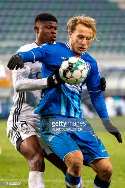 Eupen's Emmanuel Agbadou and Gent's Roman Bezus fight for the ball during a soccer match between KAA Gent and KAS Eupen, Sunday 07 February 2021 in...