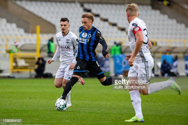 Eupen's Gary Magnee and Club's Noa Lang fight for the ball during a soccer match between Club Brugge KV and KAS Eupen, Saturday 26 December 2020 in...
