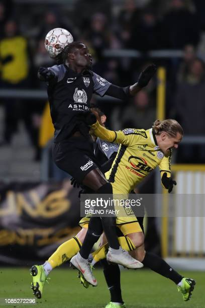 Eupen's Mamadou Fall and Lokeren's Ari Freyr Skulason fight for the ball during a soccer match between KAS Eupen and Sporting Lokeren Saturday 19...