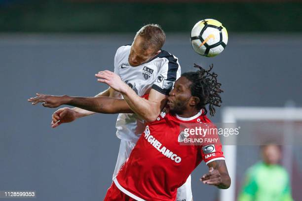 Eupen's Siebe Blondelle and Antwerp's Dieudonne Mbokani Bezua fight for the ball during a soccer match between Royal Antwerp FC and KAS Eupen Sunday...