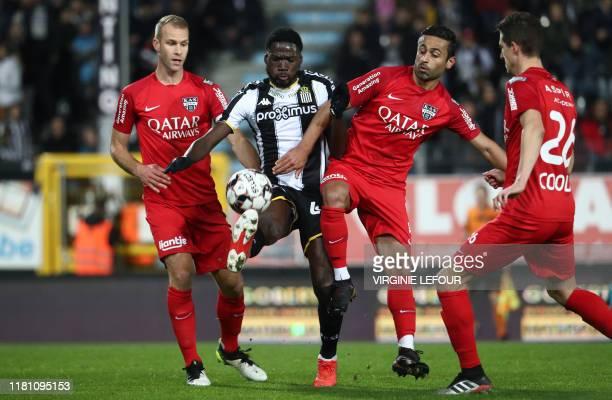 Eupen's Siebe Blondelle Charleroi's Shamar Nicholson and Eupen's Zarandini Ebrahimi fight for the ball during a soccer match between Sporting...