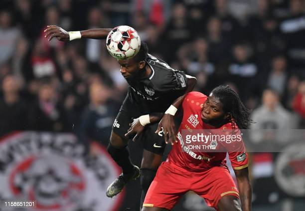 Eupen's Silas Gnaka and Antwerp's Dieumerci Mbokani Bezua fight for the ball during a soccer match between KAS Eupen and Royal Antwerp Sunday 28 July...