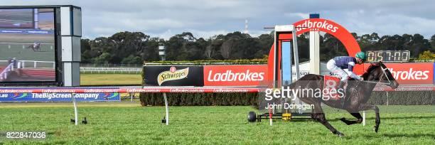 Eurack ridden by Ben Melham wins the Comcater Handicap at Ladbrokes Park Hillside Racecourse on July 26 2017 in Springvale Australia