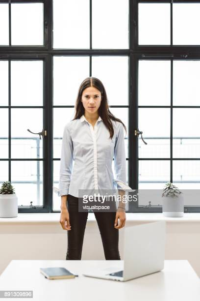 Eurasian Female Business Leader in Office