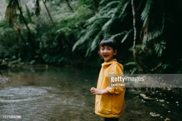 eurasian preschool girl laughing in rainforest, okinawa, japan - reality fernsehen stock pictures, royalty-free photos & images