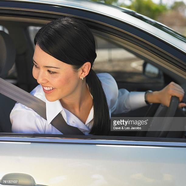 Eurasian woman driving car