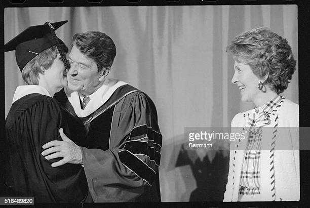 A Kiss For The President Nicolette Cox of Midlothian Illinois kisses President Ronald Reagan after she received her diploma at the Eureka College...