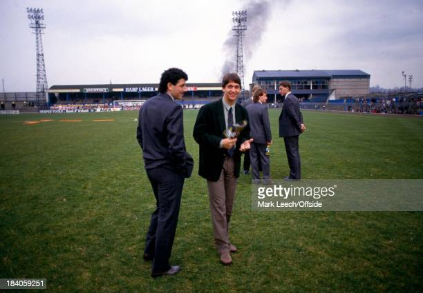 Euro 1988 Qualifier - Northern Ireland v England, Gary Lineker and Paul Ramsey stand on the Windsor Park pitch as smoke from a car bomb billows in...