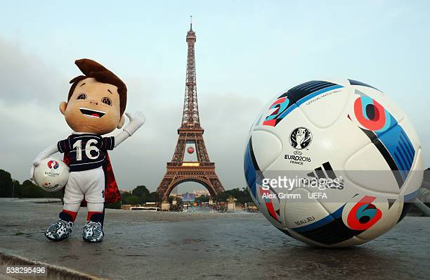 Euro 2016 toy mascot Super Victor and the official adidas match ball Beau Jeu are seen at Eiffel Tower on June 5 2016 in Paris France