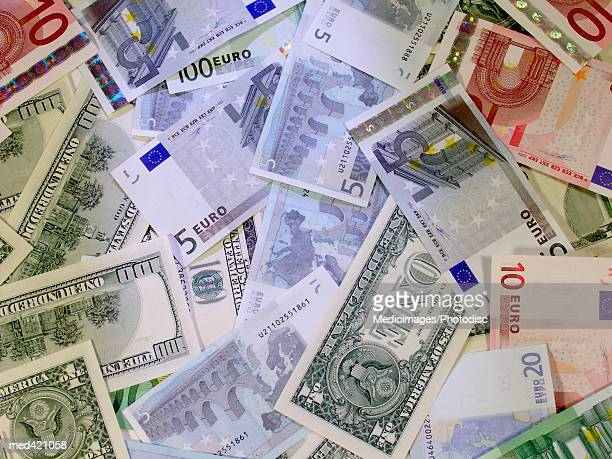 euro and american bank notes scattered - five euro banknote stock photos and pictures