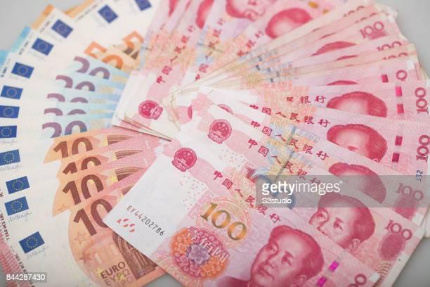 Euro and China Yuan of Mao dollar bank note are arranged for a photograph on 07 September 2017 in Hong Kong Hong Kong