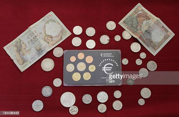 Euro and French francs banknotes and coins pictured on Decemeber 1 2011 in San Salvador AFP PHOTO / Oscar Rivera