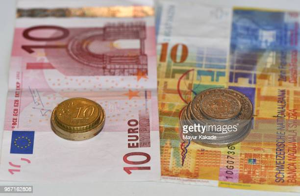 euro and swiss franc currency notes and coins - ユーロ圏 ストックフォトと画像