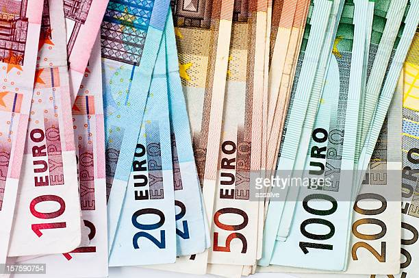 euro banknotes in a row - twenty euro banknote stock photos and pictures