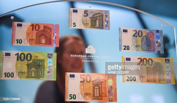 Euro banknotes including the new versions of the 100- and 200 euro banknote are pictured on September 17, 2018 in Frankfurt am Main, western Germany....