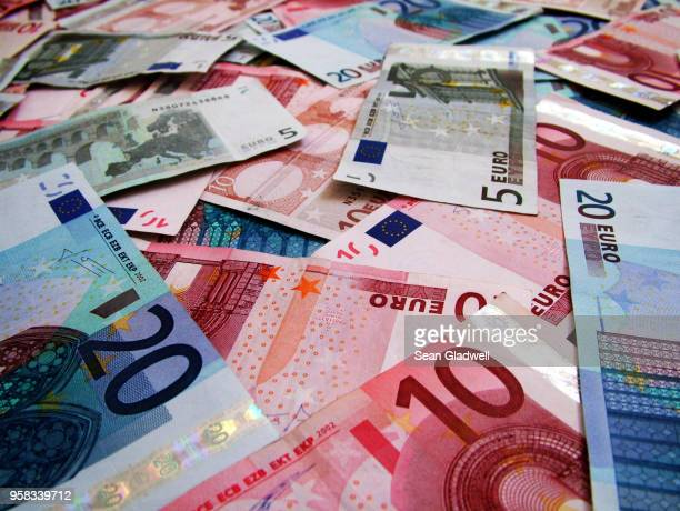 euro banknotes - euro symbol stock photos and pictures
