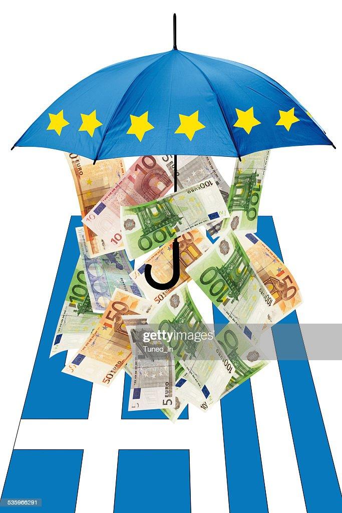 Euro banknotes under umbrella with greek flag : Stock Photo