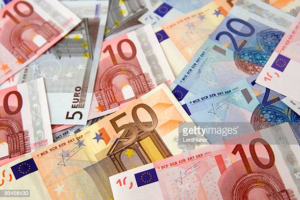 euro bills - euro symbol stock photos and pictures