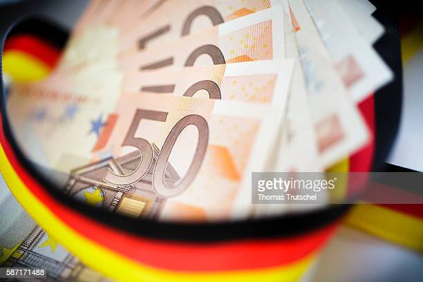 50 Euro bills with a ribbon in the national colors of Germany on August 08 2016 in Berlin Germany