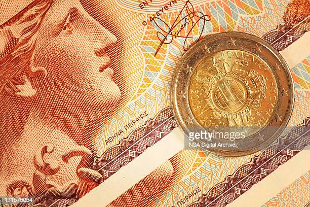 Euro Cent Coin on Greek Drachma Notes | Finance, Business
