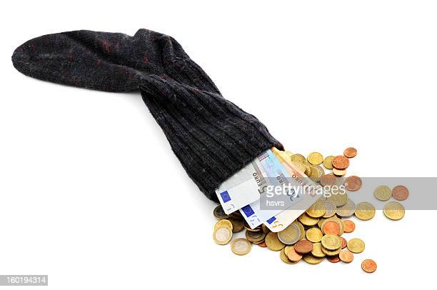 Euro coin and paper currency falling out of money sock