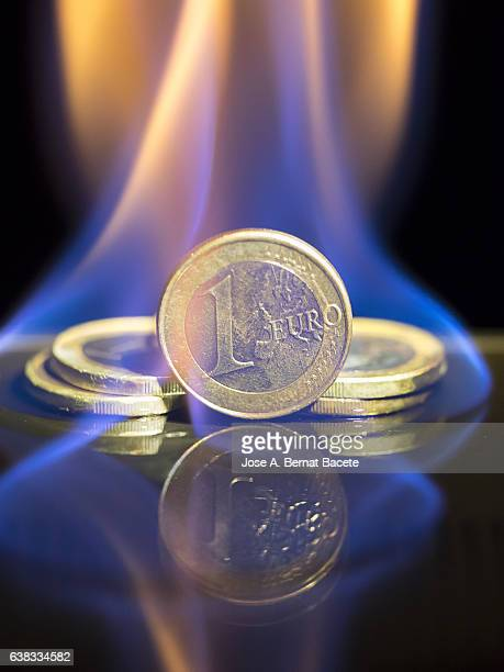 Euro coin burned by the fire of the crisis of Brexit
