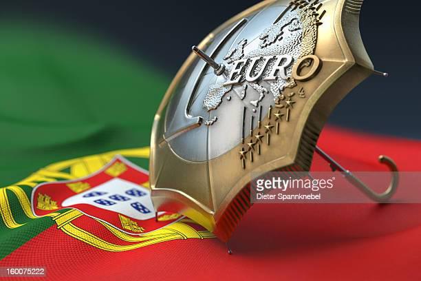 euro coin designed umbrella on a flag of portugal - bandeira de portugal imagens e fotografias de stock