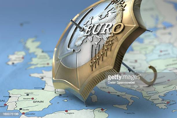 Euro coin designed umbrella on a map of europe