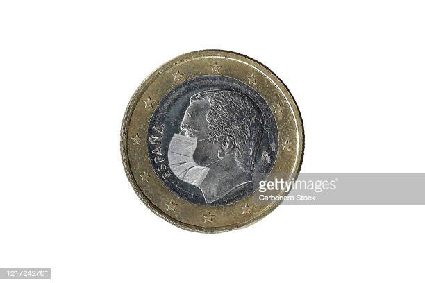 euro coin from spain with medical mask - felipe vi of spain stock-fotos und bilder
