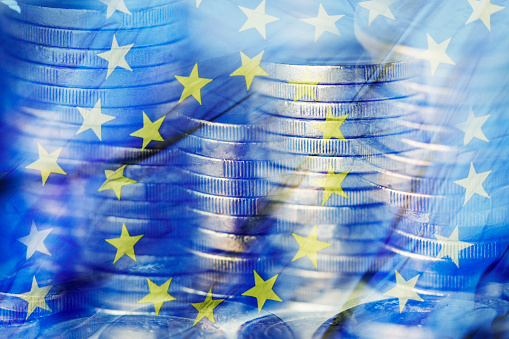 euro coins and the flag of the European Union 905898542